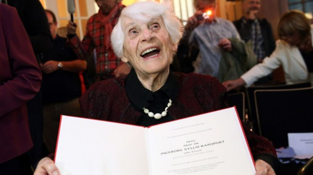 Ingeborg Sylim-Rapoport shows off her diploma.